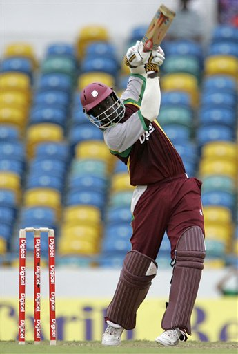 West Indies' Xavier Marshall hits a six during the international Twenty20 cricket match against Australia at Kensington Oval in Bridgetown on Friday, June 20, 2008. The West Indies won by seven wickets in the 11-overs-per-side reduced match due to rain.
