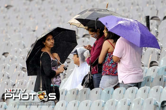 Clouds opened up in Melbourne and forced the match to be cut short to 32-overs a side. Australia eventually managed to score 216.