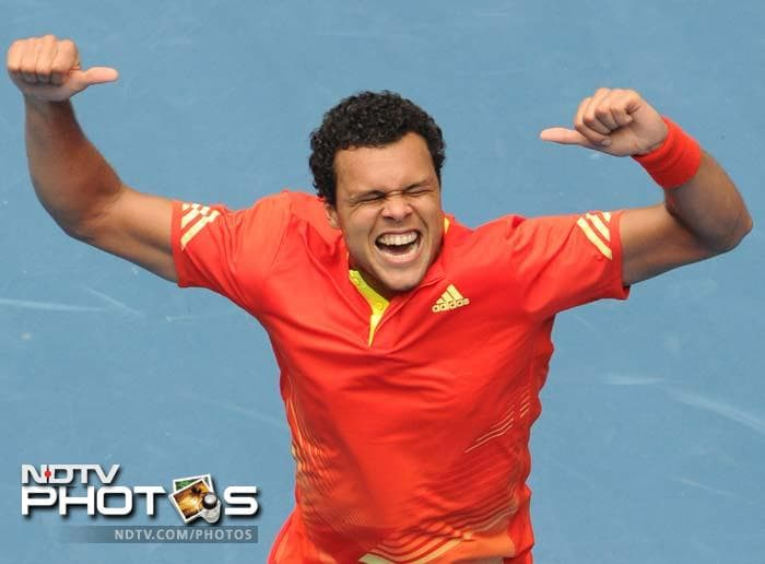 Jo-Wilfried Tsonga of France celebrates after victory in his men's singles match against Frederico Gil of Portugal. He won 6-2, 6-2, 6-2.