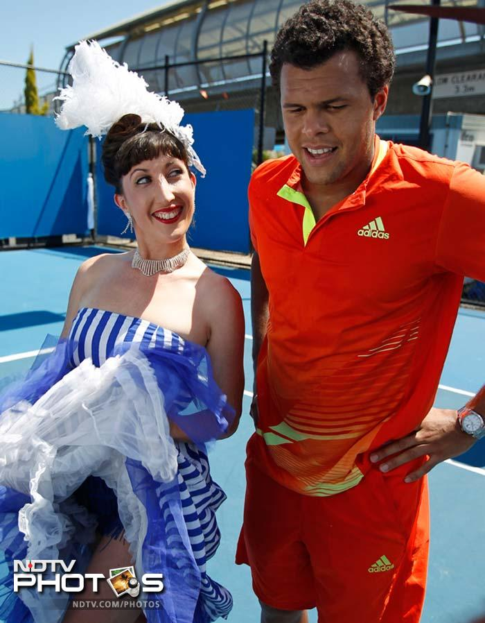It began as a fun day for Jo Wilfred Tsonga. He enjoys his moment under the sun with a Cancan dancer.