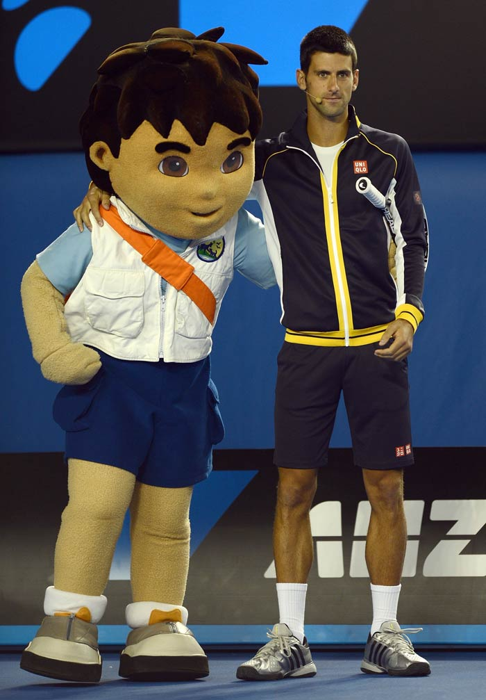 Novak Djokovic though stands firmly in Federer's way. <br><br>The Serb is seen here taking part in a Kids Day exhibition match.