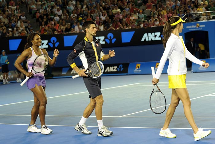 Djokovic is seen here joined by Serena Williams (left) and Ana Ivanovic as the three do their best to entertain the young fans.