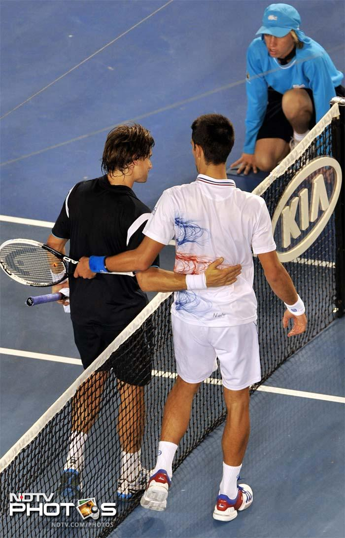 Murray will face Novak Djokovic (right) who looked a tad jaded but still managed to help himself to a win against Spain's David Ferrer.