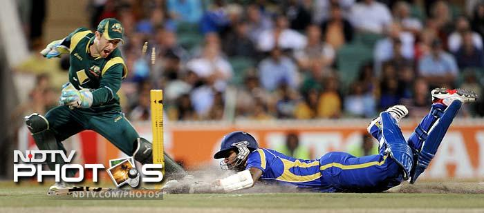 Chamara Kapugedera (R) is seen here diving but Sri Lanka only managed to hand in by the thinnest of threads.