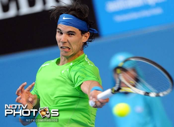 Rafael Nadal brushed aside America's Alex Kuznetsov 6-4, 6-1, 6-1, despite revealing later that he feared his bid for another Australian title was over before it started after suffering searing knee pain ahead of his first match.