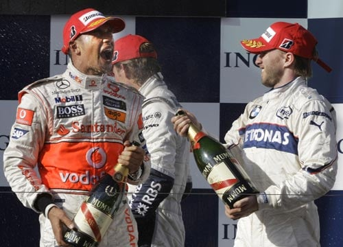 McLaren Mercedes Formula One driver Lewis Hamilton of Britain, left, is sprayed with champagne by runner up BMW Sauber driver Nick Heidfeld of Germany after winning the Australian Grand Prix in Melbourne on Sunday March 16, 2008. Hamilton won the race in front of Heidfeld and Williams Formula One driver Nico Rosberg of Germany.