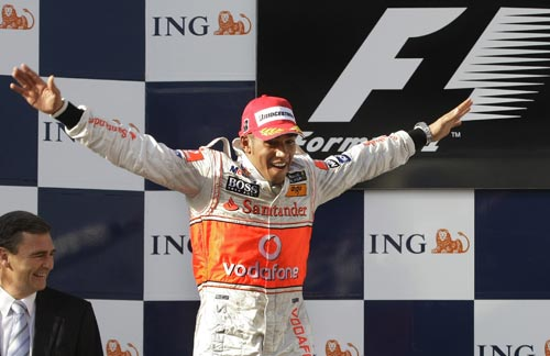 McLaren Mercedes Formula One driver Lewis Hamilton of Britain celebrates after winning the Australian Grand Prix in Melbourne on Sunday, March 16, 2008. Hamilton won the race in front of BMW Sauber Formula One driver Nick Heidfeld of Germany and Williams Formula One driver Nico Rosberg of Germany.
