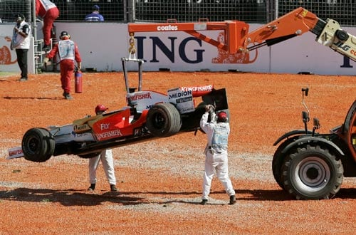 Track marshals clear Force India Formula One driver Giancarlo Fisichella of Italy's car after he crashed at turn one soon after the start of the Australian Grand Prix at the Albert Park circuit in Melbourne on Sunday, March 16, 2008.