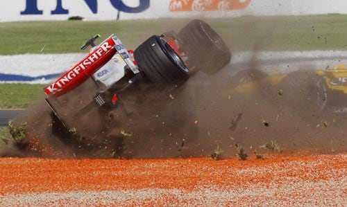 Force India Formula One driver Giancarlo Fisichella of Italy crashes at turn one at the start of the Australian Grand Prix at the Albert Park circuit in Melbourne on Sunday, March 16, 2008.