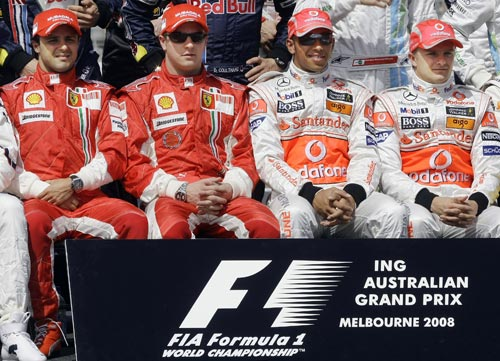 Ferrari Formula One driver Felipe Massa of Brazil, Ferrari driver Kimi Raikkonen of Finland, McLaren Mercedes driver Lewis Hamilton of Great Britain and McLaren Mercedes driver Heikki Kovalainen of Finland, from left, pose for their annual group driver's photo prior to the start of the Australian Grand Prix in Melbourne on Sunday March 16, 2008. The race is the season's opening Formula One race.