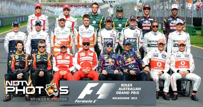Formula One drivers pose for a photograph ahead of the season opening Formula One Australian Grand Prix at the Albert Park circuit in Melbourne on March 17, 2013.