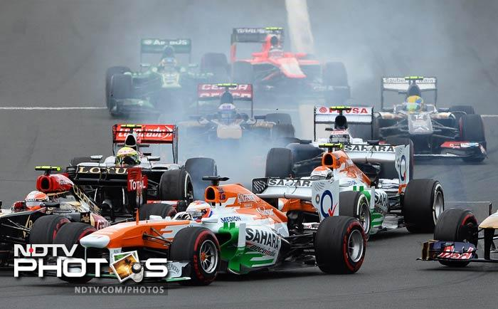 Force India pair Adrian Sutil — who twice led the race and was the man overtaken by Raikkonen for the lead — faded to seventh and finished ahead of teammate Paul di Resta. McLaren's Jenson Button and Lotus' Romain Grosjean rounded out the top 10.