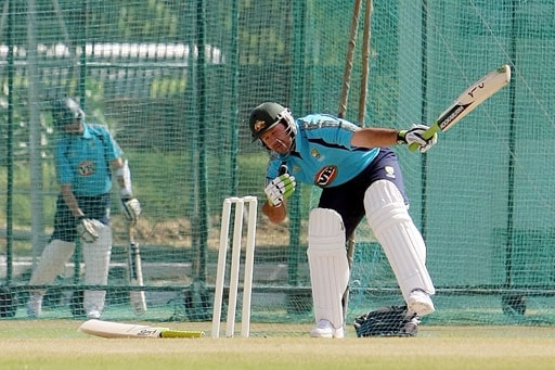 Australian captain Ricky Ponting (R) bats during a training session in Jaipur.