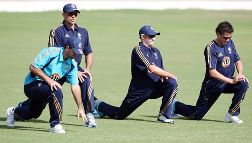 Ricky Ponting (L) stretches along with teammates Matthew Hayden (2nd L) and Michael Hussey (2nd R) during a training session in Jaipur.