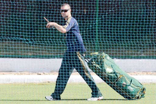 Australian cricketer Michael Clarke arrives for a training session in Jaipur.