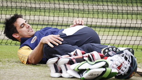 Mitchell Johnson stretches during a training session at Edgbaston cricket ground in Birmingham, England on Tuesday. (AP Photo)