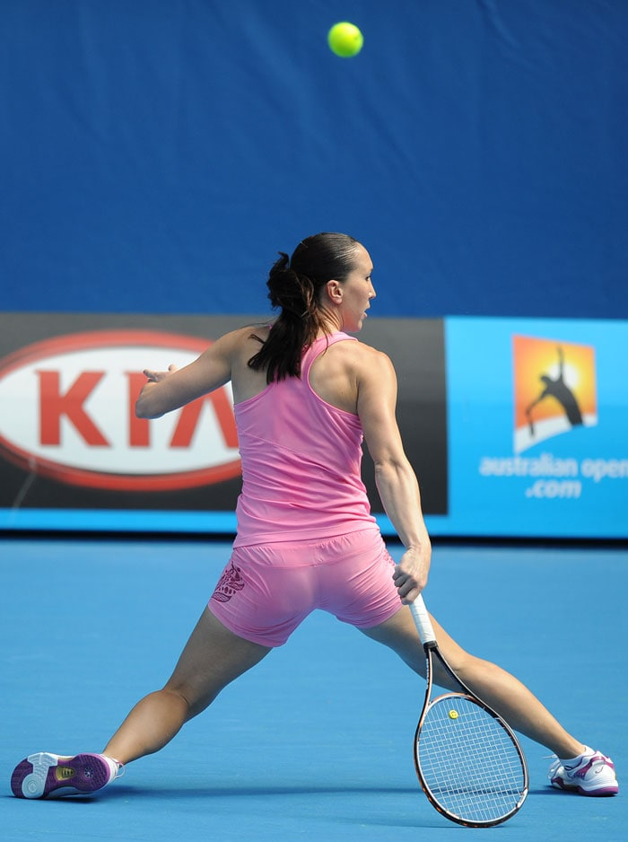Jelena Jankovic of Serbia does a mid-court split at a practice session.