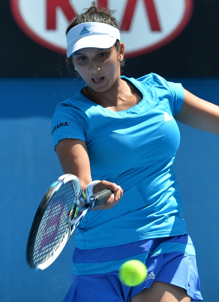 In the mixed doubles category, Sania Mirza kept India alive at the Australian Open as she and Horia Tecau stormed into the mixed doubles semis by comprehensively beating Julia Georges and Aisam-ul-Haq Qureshi 6-3, 6-4.