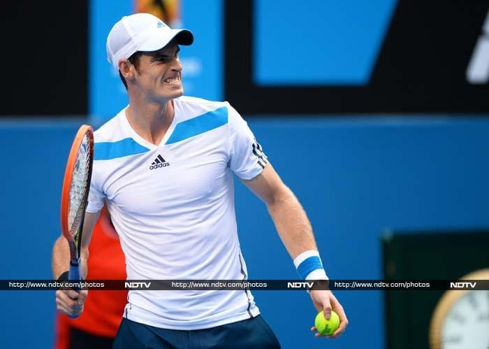 Andy Murray was taken to four sets and smashed his racquet in frustration before finally ending 'lucky loser' Stephane Robert's dream run at the Australian Open.