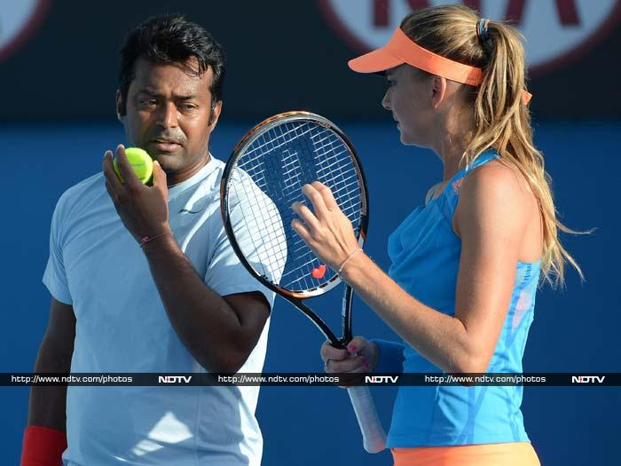 Leander Paes and his Slovakian partner Daniela Hantuchova, unseeded in the tournament, scored an upset victory over eighth seeds Mahesh Bhupathi and Elena Vesnina of Russia 6-0 2-6 10-6 to make it to the quarterfinals of the mixed doubles.