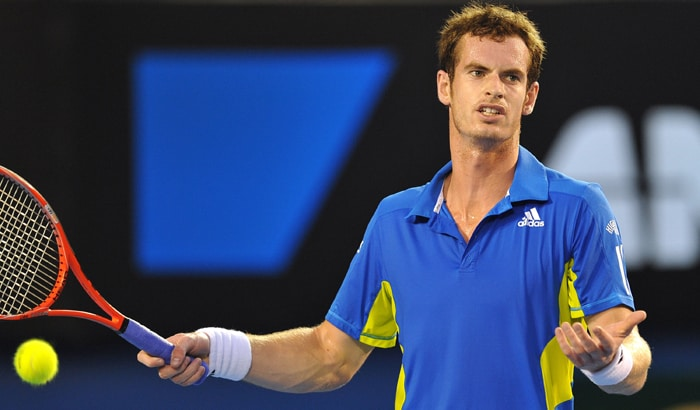 Andy Murray reacts while playing against Roger Federer in their men's singles final of the Australian Open. (AFP Photo)