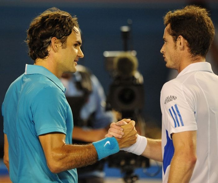Roger Federer (L) shakes hands with British opponent Andy Murray after victory in his men's singles final match against the latter at the Australian Open. This was Federer's fourth Australian Open title of his career. (AFP Photo)
