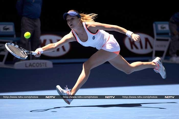 Agnieszka Radwansa played the role of underdog to perfection as she finally broke her jinx against two-time defending champion Victoria Azarenka and knocked her out of the Australian Open. The determined Pole battled to a 6-1, 5-7, 6-0 win. (All AP and AFP images)