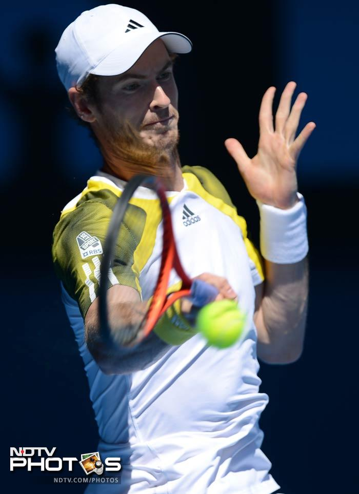 Britain's Andy Murray outclassed Dutchman Robin Haase in straight sets to advance to the second round.