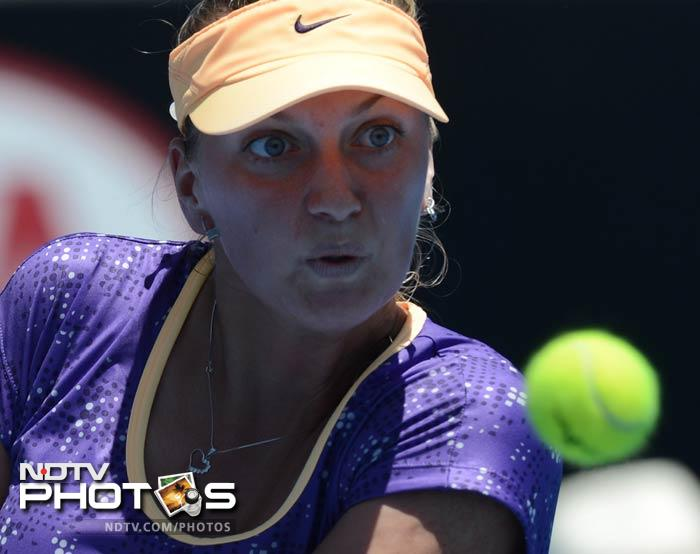 Former Wimbledon champion Petra Kvitova advanced to the second round with a 6-4, 2-6, 6-2 victory over Italy's Francesca Schiavone.