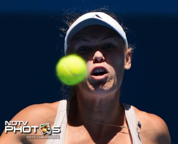 Caroline Wozniacki scrambled to a 2-6, 6-3, 6-3 triumph over big-serving German Sabine Lisicki. <br><br> She later thanked boyfriend Rory McIlroy who stayed up late to catch her match live.