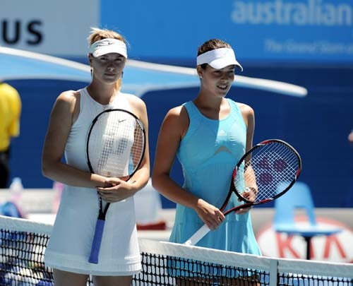 Serbia's Ana Ivanovic, right, and Russia's Maria Sharapova pose for a photo at the net before the start of the final of the Women's singles at the Australian Open tennis tournament in Melbourne on Saturday, January 26, 2008.