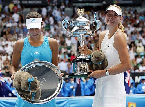 Russia's Maria Sharapova, right, and Serbia's Ana Ivanovic, left, hold their trophy after Sharapova won the final of the Women's singles at the Australian Open tennis tournament in Melbourne on Saturday, January 26, 2008.