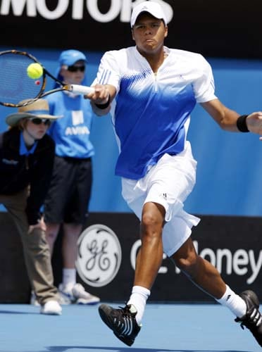 Jo-Wilfried Tsonga of France returns to Sam Warburg of the US during their second round Men's Singles match at the Australian Open tennis championships in Melbourne on Wednesday, January 16, 2008.