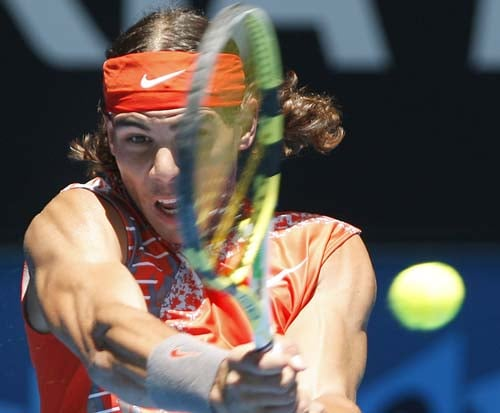 Rafael Nadal of Spain returns to Florent Serra of France during their second round Men's Singles match at the Australian Open tennis championships in Melbourne on Wednesday, January 16, 2008.