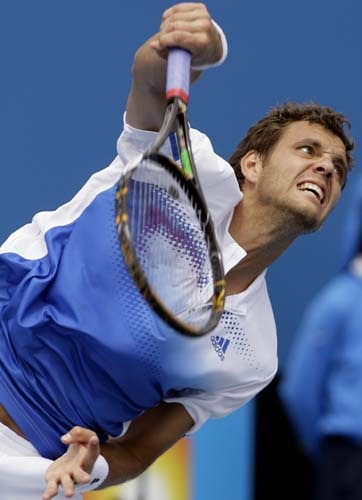 Paul-Henri Mathieu of France serves to Paul Capdeville of Chile during their second round Men's Singles match at the Australian Open tennis championships in Melbourne on Wednesday, January 16, 2008.