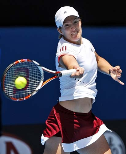 Justine Henin returns the ball to Russia's Olga Poutchkova during a second round Women's singles match at the Australian Open tennis championships in Melbourne on Wednesday, January 16, 2008.