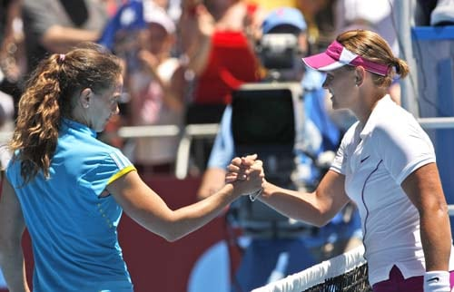 Casey Dellacqua of Australia, right, greets Patty Schnyder of Switzerland at the net after winning their second round Women's singles match at the Australian Open in Melbourne on Wednesday, January 16, 2008.