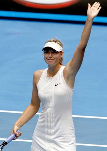 Russia's Maria Sharapova waves to spectators after beating Elena Vesnina of Russia in their third round women's singles match at the Australian Open tennis championships in Melbourne on Friday, January 18, 2008.