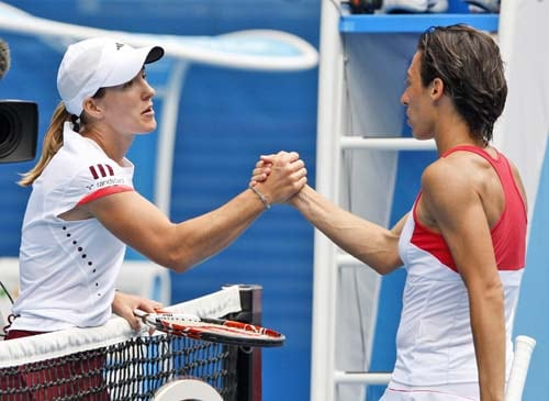 Justine Henin, greets Francesca Schiavone of Italy at the net after beating her in a Women's singles match at the Australian Open tennis championships in Melbourne on Friday, January 18, 2008.