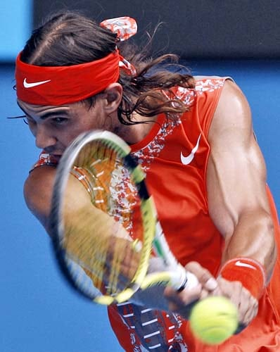 Spain's Rafael Nadal returns to Gilles Simon of France in a Men's singles third round match at the Australian Open tennis championships in Melbourne on Friday, January 18, 2008.