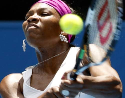 Serena Williams of the United States returns the ball to Victoria Azarenka of Beralus in their third round women's singles match at the Australian Open tennis championships in Melbourne on Friday, January 18, 2008.