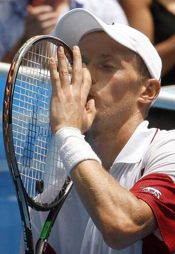 Russia's Nikolay Davydenko kisses his racquet after beating Marc Gicquel of France in a Men's singles third round match at the Australian Open tennis championships in Melbourne on Friday, January 18, 2008.