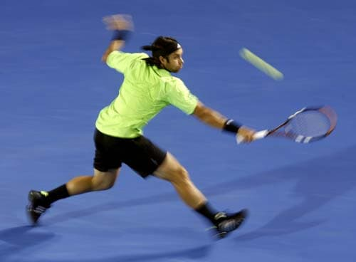 Chile's Fernando Gonzalez returns the ball to Marin Cilic of Croatia in their third round Men's Singles match at the Australian Open tennis championships in Melbourne on Saturday, January 19, 2008.