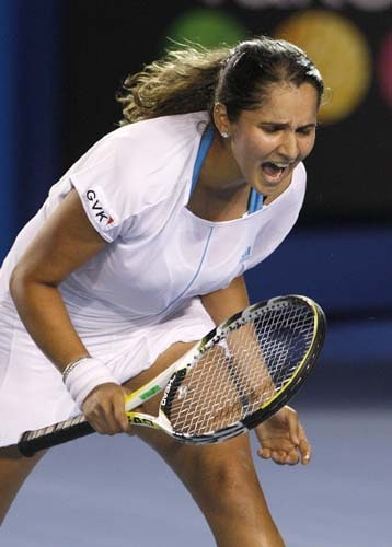 Sania Mirza reacts as she plays Venus Williams of the United States in a Women's singles third round match at the Australian Open tennis championships in Melbourne on Saturday, January 19, 2008.