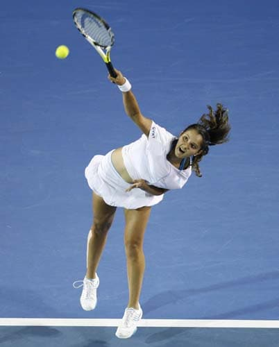 Sania Mirza serves to Venus Williams of the United States in a Women's singles third round match at the Australian Open tennis championships in Melbourne on Saturday, January 19, 2008.