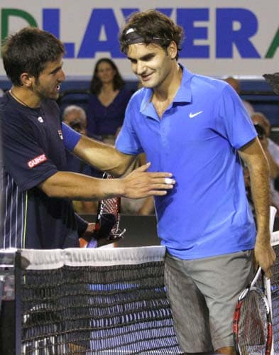 Switzerland's Roger Federer, right, greets Serbia's Janko Tipsarevic at the net after winning their third round Men's Singles match at the Australian Open tennis championships in Melbourne on Saturday, January 19, 2008.