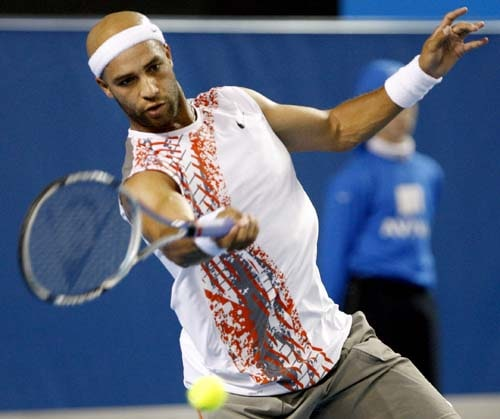 James Blake of the United States returns to Sebastien Gosjean of France during their men's singles third round match at the Australian Open tennis championships in Melbourne on Saturday, January 19, 2008.