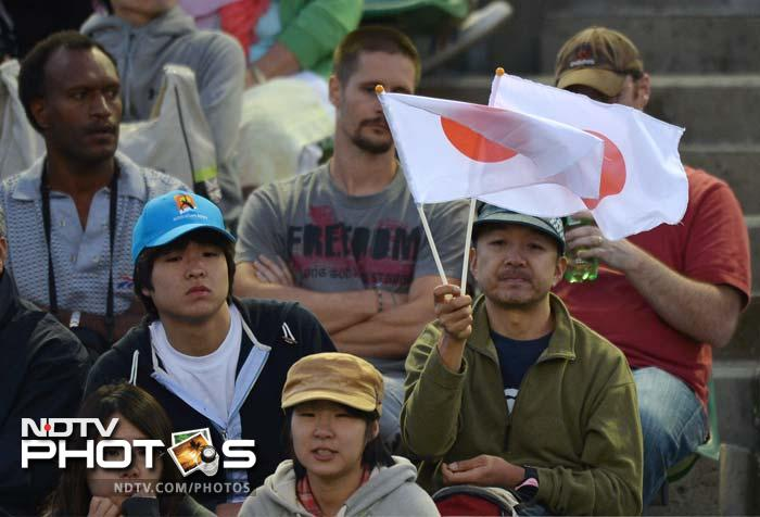Japanese fans not shy to display their national flag as they look on.