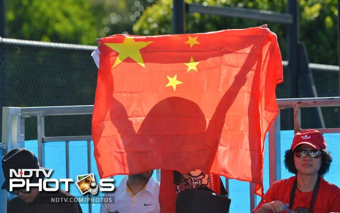 Flags used as a shade in the sweltering heat for some fans.