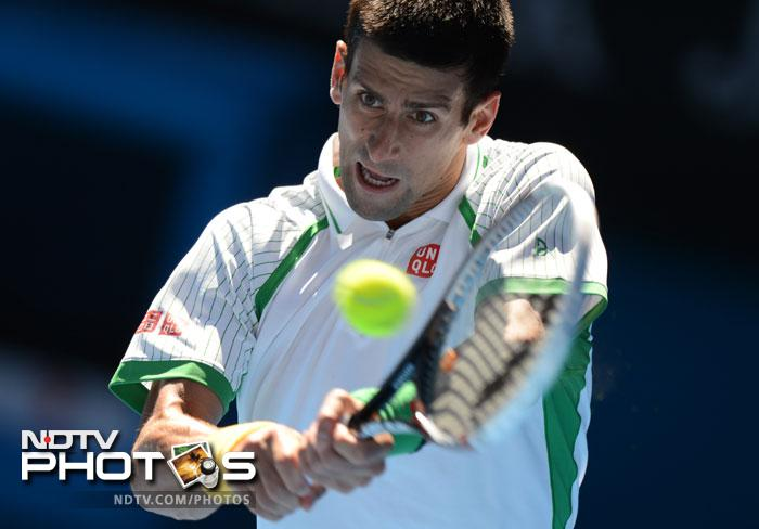 Novak Djokovic started his title defense in grand style packing off Paul-Henri Mathieu 6-2, 6-4, 7-5 to cruise into the second round.